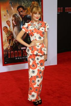 Crop top, maxi-length, peplum ruffle: Bella Thorn's red carpet outfit has three major trends going on! While the head-to-toe poppy print makes a statement on its own, it also pulls all of these elements together for a whimsically glamorous look.