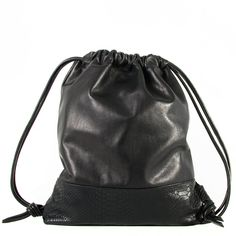 Minimal gift ideas from S2 20 - Hege in France - black leather drawstring bag handmade from Daphny Raes