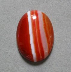 Red carnelian a.k.a. Blood of Isis stone--2nd chakra. Aids in remembering the lost or forgotten parts of yourself, and spiritual clarity.  Evokes calming of anger, feminine qualities to balance the male and female energies, forgiveness, grief acceptance, and acceptance of changes through life cycles.  Assists in healing blood, fertility organs, infertility, menopause, and PMS.  Use:  Wear or position as appropriate.