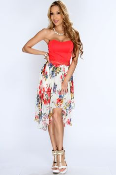 Show off your sense of style when you appear in this floral print dress! Jump into spring early this season and add it to your wardrobe collection! Youll love it the moment you try it on! It features floral print, strapless, sweetheart neckline, light padded, sheer overlay, floral mesh midsection, draped sides, and fitted. 100% Polyester. Made in USA.