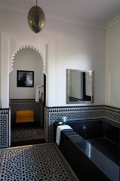 Not the colors, but the style I LOVE. Black and white moroccan tile, black tub.