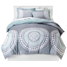 Elegant yet bold, the Room Essentials Medallion Duvet Cover Set sets a soothing tone with a gray and white pattern accented with soft blue. 180-thread-count duvet sets are available for full/queen or king beds, with each neutral-tone bedding set including a slip-on cover and 2 matching standard-size pillow shams. 100% polyester.