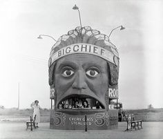 22 Jul 1933, Kansas City, Missouri, USA --- Kansas City: Heap Big Injun Chief. This fifteen feet tall, ten feet wide likeness of an Indian Chief attracts passing motorists on U. S. Highway number 40 at Kansas City, Missouri, to the refreshment sold within. --- Image by Bettmann/CORBIS