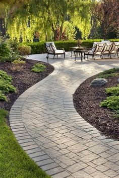 A patio design may include brick walkways as part of the outdoor living design. A patio design may include brick walkways as part of the outdoor living design… A patio design may include brick walkways as part of the outdoor living design… Concrete Patios, Brick Patios, Brick Walkway, Outdoor Walkway, Patio Slabs, Stamped Concrete Walkway, Paver Path, Cobblestone Walkway, Stone Driveway