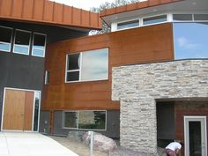 Cold rolled steel flat lock siding and cold rolled steel panel wrapped fascia