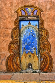 Door in Santa Fe New Mexico Graphics add interest to outdoor structures. I just finished some on my patio wall. - November 09 2019 at Cool Doors, Unique Doors, Doors Galore, Porte Cochere, When One Door Closes, Knobs And Knockers, Door Gate, Grand Entrance, Painted Doors