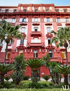 The apartment building's architecture is Stile Liberty, Italy's answer to Art Nouveau.