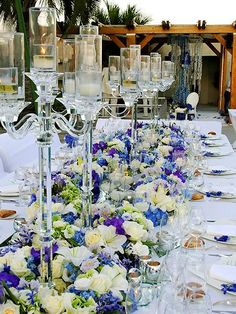 Ivory, blue and purple wedding flowers with tall crystal clear candleabra decor Candleabra Wedding Centerpieces, Candelabra Centerpiece, Centerpiece Decorations, Wedding Decorations, Centrepieces, Wedding Reception Design, Outdoor Wedding Reception, Wedding Table, Wedding Colors