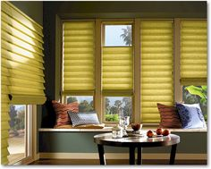 Roman blinds that go up, down or anywhere in between.  Love this.  Allows privacy while still letting in light.