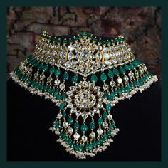 Classic Sabyasachi Necklace from the Sabyasachi Heritage Jewelry collection, crafted in 22k gold with uncut diamond, emerald and pearl.  For all jewellery related queries, kindly contact sabyasachijewelry@sabyasachi.com  #Sabyasachi #SabyasachiJewelry #TheWorldOfSabyasachi