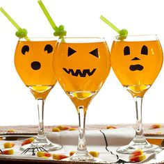 Halloween cocktail -  use dollar store wine glasses and magic marker.