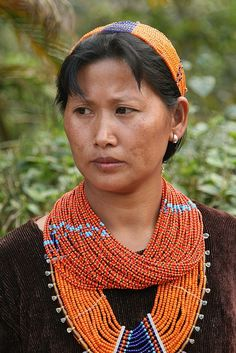 A woman of the Naga people wesring her fine strung bead necklaces at the Aoling (Konyak's New Year Festival) at Mon village (Nagaland, India) We Are The World, People Around The World, Naga People, Amazing India, Indian People, World Of Color, Folk Costume, Portraits, Tribal Jewelry