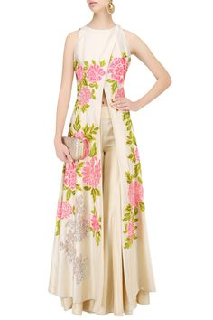 Description Featuring a beige overlap kurta in dupion crepe fabric with pink- green resham embroidery and sequins highlighting. It comes along with beige sharara in dupion crepe fabric.   FIT: Fitted at bust. COMPOSITION: Dupion crepe CARE: Dryclean only.
