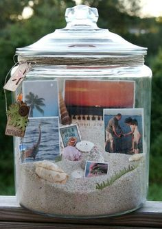 For this beach memory jar, start by filling the jar about 1/3 of the way with sand. Tip the jar to create an angled landscape to easily see all the elements inside the jar. Print several photos, either 3 x 5, wallet size and/or contact sized and insert them into the sand. Add shells, any other collectibles, and then wrap twine around the top of the jar. Once everything inside is set, add the lid 1and the memory jar is complete.  -Ultimate Women's Expo