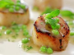 As seen on Barbecue Addiction: Caramelized Scallops with Fresh Green Pea Vinaigrette #Scallops #BobbyFlay