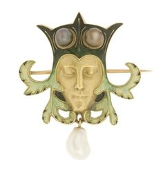 Brooches with heads by René Lalique, late 1890s-early 1900s.