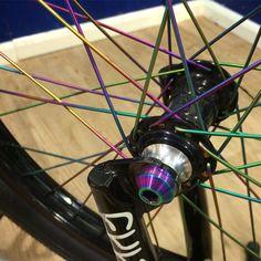 Nice shot of our ultra lightweight Rainbow Titanium spokes and hub bolts from team rider @jonnyboi3 #bmx #tlcbikes #tispokes #titaniumspokes #oilslickbmx #profileracing #cultcrew #bikeparts #bmxparts