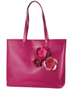 Receive a FREE Pink Tote with any $50 purchase from the Elizabeth Arden fragrance collection