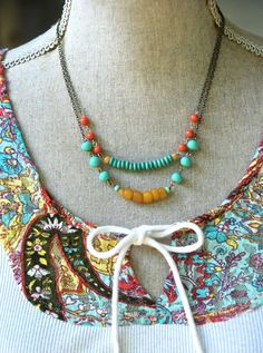 Emmy...  loved a splash of color  features assorted vintage glass beads and artisan cut beads,antique brass chain  measures 16 and 18