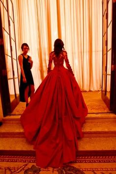 I am in love with this crimson Marchesa gown
