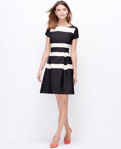 "Perfect from day to night, this one-piece wonder boasts bold stripes and a mod silhouette in the season's most arresting colors. Add fresh-hued heels for a pop of brightness. Boatneck. Short sleeves. Inverted box pleats at waist. Hidden back zipper with hook-and-eye closure. Lined body. 19 1/2"" from natural waist."