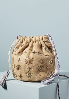 Presented by Anthropologie. Beaded blooms pop against a sun-bleached jute background on this seasonally appropriate style. Viva Luxury, Potli Bags, Creative Textiles, Weaving Textiles, Fall Accessories, Unique Bags, Handmade Bags, Bag Making, Bucket Bag