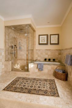 Impressive wall candle sconces in Bathroom Traditional with Thermasol Steam Shower next to Separate Shower And Tub alongside Neutral Tile and Soaking Tub And Shower