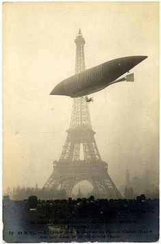 """The airship, Le Jaune, built by France's Lebaudy brothers, glided past the Eiffel Tower in Paris at a. on November The name Le Jaune (""The Yellow"") came from a coat of yellow lead chromate that was used to seal the airship envelope. Vintage Pictures, Old Pictures, Old Photos, Paris Torre Eiffel, Paris Eiffel Tower, Old Paris, Vintage Paris, Zeppelin, Tours"