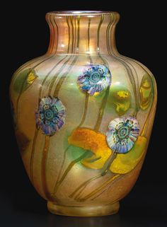 """TIFFANY STUDIOS """"Anemone"""" Paperweight Vase Estimate $20,000 - $30,000 6 3/4  in. (17.1 cm) high favrile glass"""