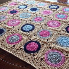 Pattern: Gumball blanket – info here! Materials:Beautiful pink and navy room décor - grey and tan cool the palette down. Size K hook Construction Features: Join as you go Similar Pieces: Gumball...