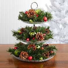 Holiday Centerpiece: Traditional – The Pampered Chef®Using Pampered Chef's 3 tiered shimmering glass plates!biz/kris - to place your order. Christmas Greenery, Cozy Christmas, Outdoor Christmas, Christmas Time, Christmas Crafts, Xmas, Christmas Ideas, Holiday Centerpieces, Christmas Table Decorations
