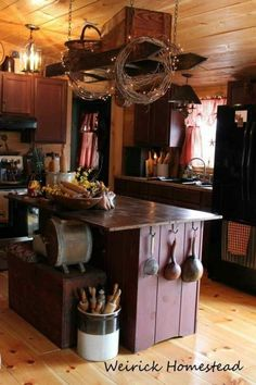 Primitive Kitchen...old ladder hanging from the ceiling. #PrimitiveKitchen #PrimitiveCountryDecorating
