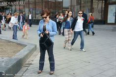 Random photos. Street fashion in Moscow, Russia. April 2012. Youth fashion. Women fashion. Men fashion. Colored pants. odigif@gmail.com photo.