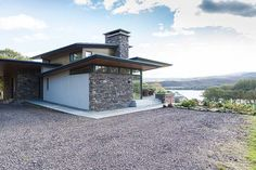 The exterior of this house mixes dry stone walling with white render