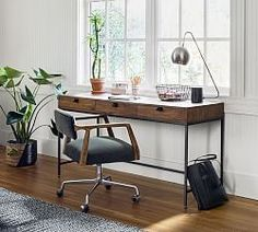 Taking the mixed material trend to the next level, this home office collection fearlessly mixes wood, metal and leather for a look you'll love to work with. Unexpected drawer pulls, faux dovetail edge work and a high-low finish are the in Wood And Metal Desk, Metal Desks, Wood Desk, Office Decor, Home Office, Office Ideas, Office Inspo, Desk Office, Office Spaces