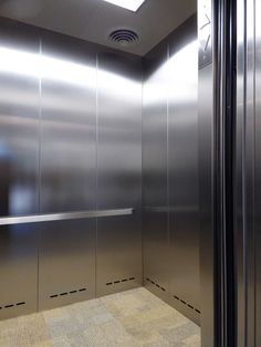 Durable Elevator Interior Cab by G&R Custom Elevator Cabs using textured stainless steel Pattern 5WL®.