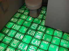 Flooring Idea:    Gloriously glowing green repurposed street signs  ~ as wallcovering???