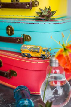Retro suitcases, vintage toy car, light bulb vase. Products from Wild Floral Designs, photographed by Georgina at Panache photography all rights reserved 2015.