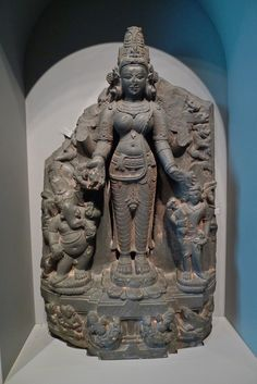 The  Hindu  deity  pavarti  with  her  sons  ganesha  and  skanda  th  century  Indian  and  Asian  art  Museum  of  San  Francisco