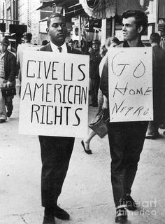 """""""Give us American rights"""" - """"Go home negro."""" Photo from the Greensboro, North Carolina sit-ins, A black student pickets outside Woolworth's in support of the lunch counter sit-in taking place inside. A white counter-demonstrator keeps in step with him. Plakat Design, Black History Facts, Women's History, Ancient History, Protest Signs, Civil Rights Movement, Power To The People, Rosa Parks, African American History"""
