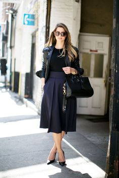 Fashion risk to try: pairing black and navy | full navy midi skirt worn with a black top, black leather jacket + pointy black heels | StyleCaster