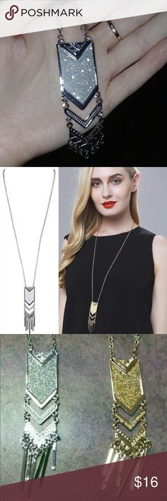 "Silver Tassel Long Chain Pendant Necklace This listing is for the silver-tone necklace, but we carry this in gold, too.  The 26"" chain is adjustable to any link on the chain with quality clasp.  Sparkling ethnic boho pendant is 3 1/2"" in length.  Light and comfortable to wear.  A perfect compliment for so many dresses and tops!   Brand new with tags in manufacturer packaging.  We ship fast... Typically every day. (B2) Jewelry Necklaces"
