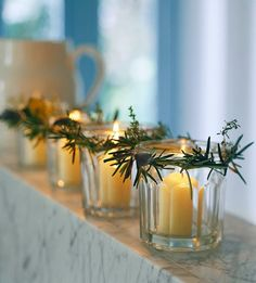 DIY: mini  rosemary wreaths on votives .......  I'm dreaming of  ....#white #Christmas #holiday #decorations #snow #fire_place #Santa #winter #presents #gifts #cooking #love #gingerbread #Christmas_tree #lights #wine #hot_chocolate .. www.morseandnobel.com