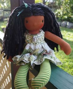 "This is Jaelle, she is a 13-14"" Pooki angel.   Her eyes are dark brown and her hair is long handspun yarn.   Her outfit is from Munkiez and her necklace is from Bling for Ewe."