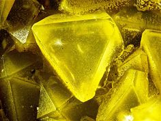 Arsenolite, White Caps Mine, Manhattan District, Nye Co., Nevada, USA. Octahedral yellow crystals. Fov 2 mm. Collection: Lithothek Munich Micromounter. Copyright: Bebo