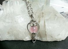 Check out this item in my Etsy shop https://www.etsy.com/listing/484456743/rose-quartz-spinner-necklace-fidget