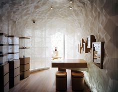 "Shang Xia | kengo kuma and associates    ""The fabric (triaxially folded) that covers the entire interior of the shop was heat-treated and shaped in Japan. It is a material which comes between cloth and plastic, which can retain the softness of natural cloth and strength of shape-memory texture."""