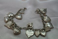 Gorgeous vintage genuine Sterling silver bracelet with 16 heart silver pendant charms,signed Mauritius sterling silver,dangle charms by antiquevintagenstuff on Etsy