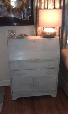 Vintage slant top desk painted with Annie Sloan Chalk paint.  The outside is a mixture of Paris Gray and Old White.  The inside Duck blue.  The knobs are from Vintage Skye on Etsy.  She makes fabulous ceramic knobs.