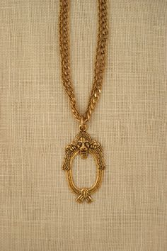 Long Necklace with French Buckle pendant by ExVoto Vintage Jewelry. The Leona Necklace #vintagejewelry #paris #goldjewelry